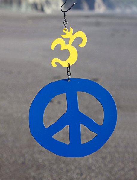 Small Om in yellow with medium peace in blue.